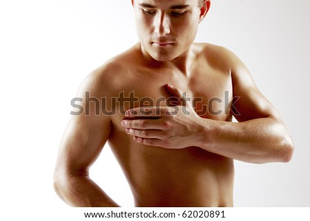 Young man holding on chest