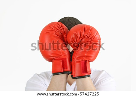 Young man holding red box gloves on white background