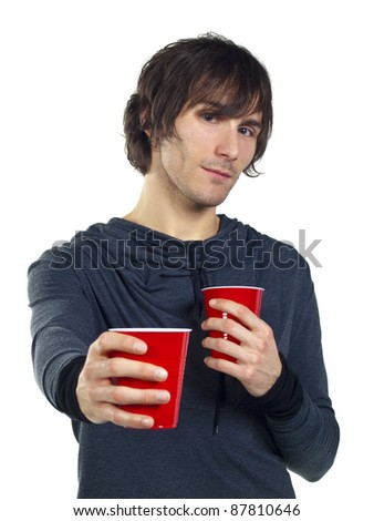 Young man holding red plastic drinking cups - stock photo