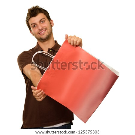 Young Man Holding Shopping Bag On White Background