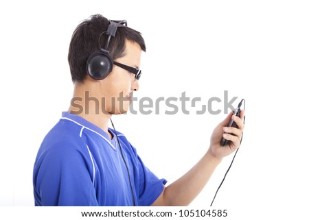young man holding smart phone and listen music