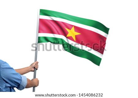 Young man holding Suriname Flag in White Background, Flag of Suriname #1454086232