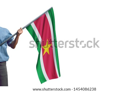 Young man holding Suriname Flag in White Background, Flag of Suriname #1454086238