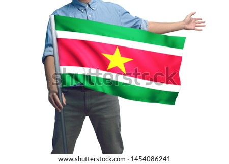 Young man holding Suriname Flag in White Background, Flag of Suriname #1454086241