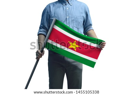 Young man holding Suriname Flag in White Background, Flag of Suriname #1455105338