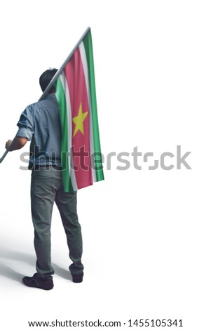 Young man holding Suriname Flag in White Background, Flag of Suriname #1455105341