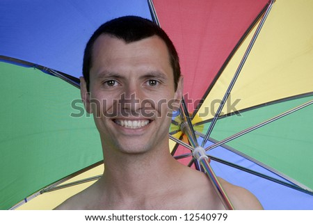 young man holding umbrella with gay colors