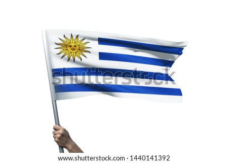Young man holding Uruguay Flag in White Background, Flag of Uruguay. #1440141392