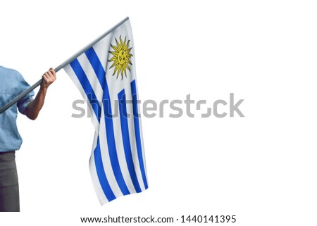 Young man holding Uruguay Flag in White Background, Flag of Uruguay. #1440141395