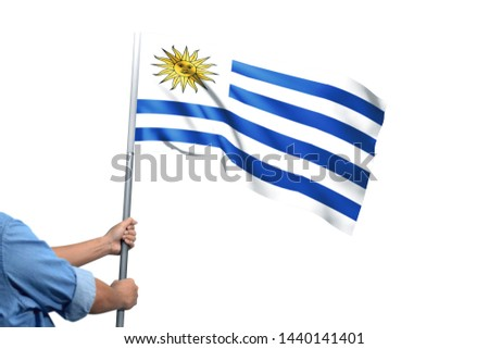 Young man holding Uruguay Flag in White Background, Flag of Uruguay. #1440141401