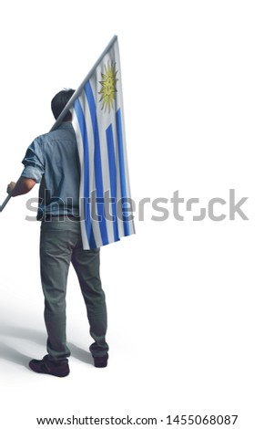 Young man holding Uruguay Flag in White Background, Flag of Uruguay #1455068087