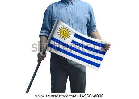 Young man holding Uruguay Flag in White Background, Flag of Uruguay #1455068090