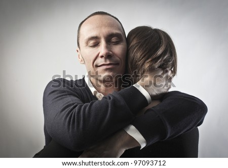 Young man hugging his wife