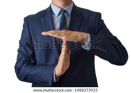 Young man in a blue suit holds hands in a timeout sign, isolate on a white background Stock photo ©