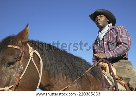 young man in a cowboy outfit...