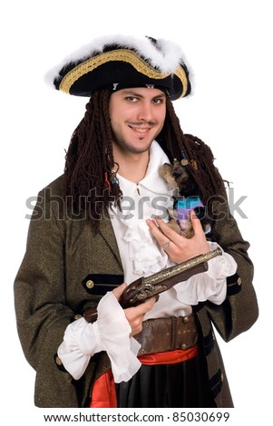 Young man in a pirate costume with small dog