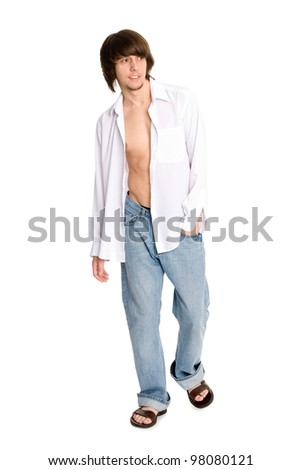 young man in a white shirt and jeans