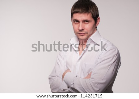 Young man in a white shirt studio photo