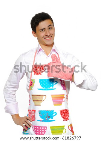 Young man in apron preparing to cook romantic dinner