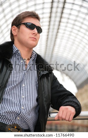 young man in black jacket and sunglasses