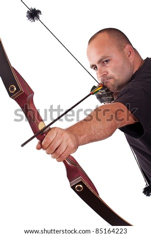 Young man in black shirt holding bow and shooting to target isolated in white