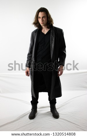 Young man in black trench coat  Stock photo ©