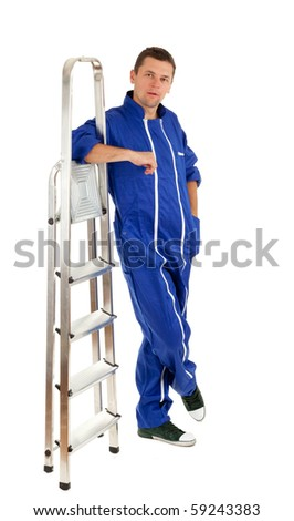 young man in blue coveralls with metal ladder