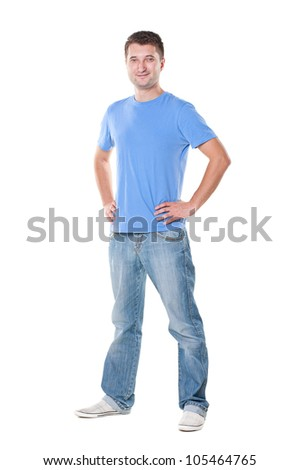 young man in blue t-shirt standing over white background