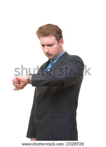 Young man in business suite looking at his watch frowning isolated on white