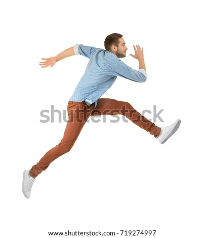 Young man in casual clothes running on white background Сток-фото ©