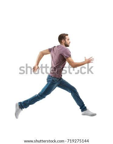 Young man in casual clothes running on white background #719275144