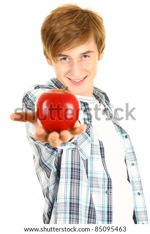 young man in casual shirt offering a red apple