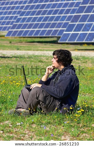 Young man in Central of photovoltaic panels.