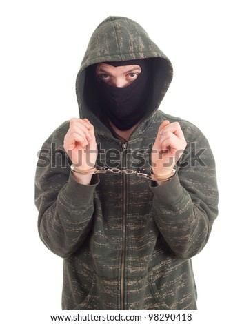 young man in dark sweatshirt and black mask with handcuffed hands