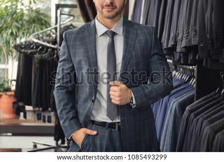Young man in elegant suit at menswear store ストックフォト ©