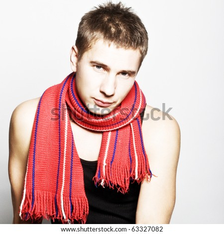 Young man in fashionable clothes studio photo shooting