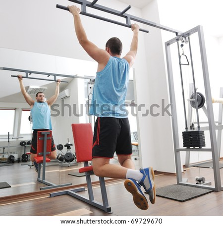 young man in fitness sport club exercise with weights and relaxing