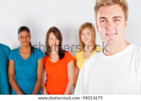 young man in front of group of people