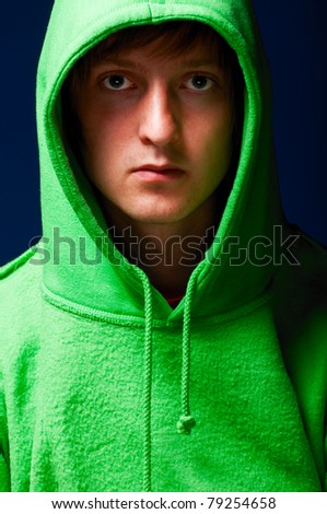 young man in green sweatshirt with turned up hood