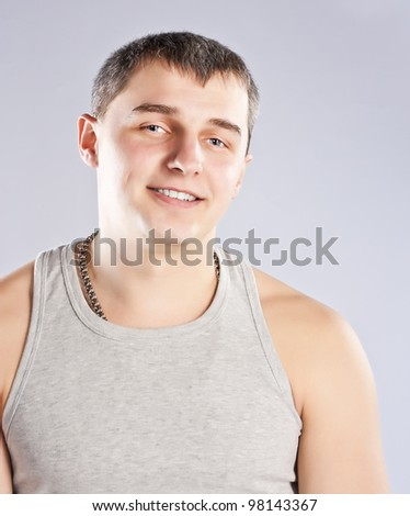 Young man in grey t-shirt studio shot #98143367