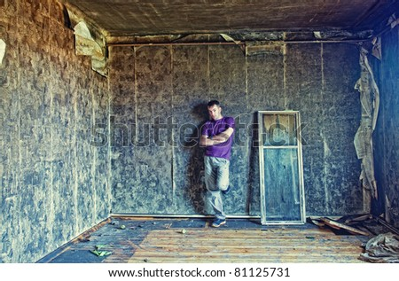 young man in grunge interior