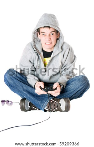 Young man in hood with a joystick for game console