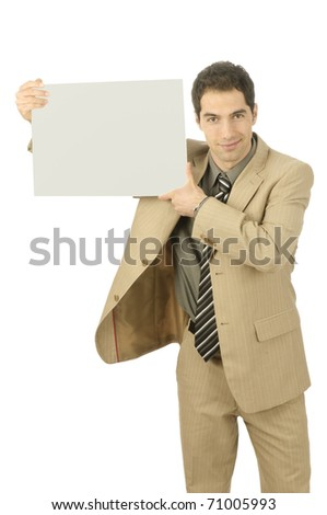 Young man in light suit holds an empty plate in the camera, isolated on a white background