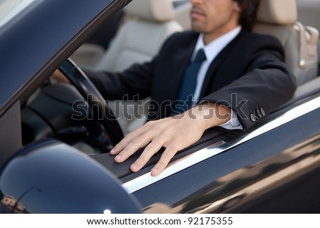 Young man in luxury sports car