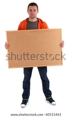 young man in orange sweatshirt keeping cork board