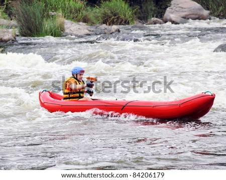 Young Man in Raft on Extreme White Water River