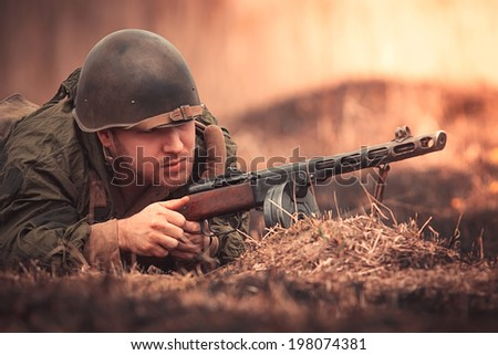 Submachine gun stock photos illustrations and vector art