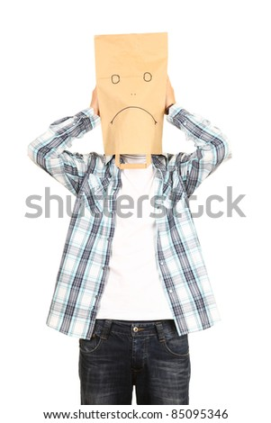 young man in sad ecological paper bag on head - stock photo