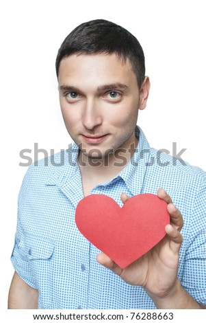 Young man in shirt holding red heart shape isolated on white - stock photo