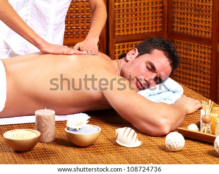 Young man in Spa massage salon. Relax.